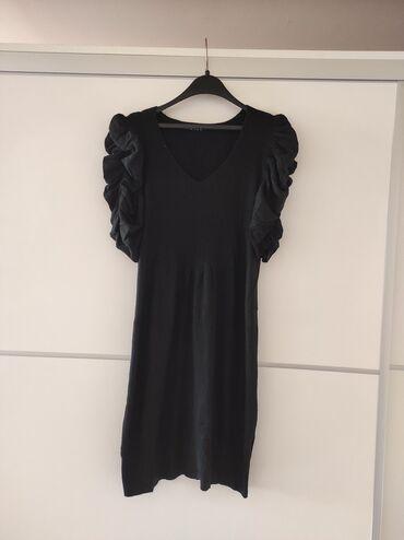 Crna haljina ili tunika. Trikotazna. Ima elastina. Poluobim grudi 39