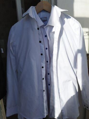 Школьные брюки и беле рубашки б/у мальчику примерно