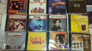 IPod və MP3 Pleyerlər - Azərbaycan: Музыкальные Mp 3 диски зарубежный рок12 щтук 15 манат6 щтук 10 манат