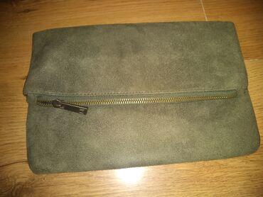 Pantalone boja maslinasto zelena kvalitetne super meka - Srbija: Koton pismo tasna, maslinasto zelena boja, jednom nosena. materijal