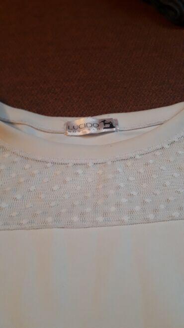 Veoma elegantno,za vitke dame  Bela bluzica dugih rukava,sa cipkom na