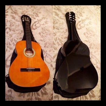 Bakı şəhərində Cataluna firmasinin 2ci el mukemmel klassik gitarasi cantasi ile birli