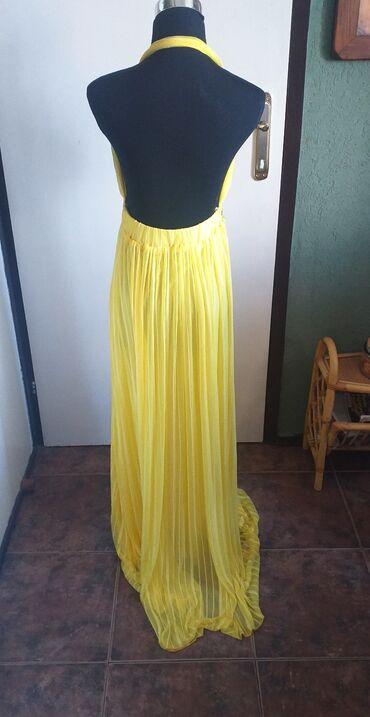 Prelepa haljina intezivno zute boje sa perlicama, leprsava, univerzaln