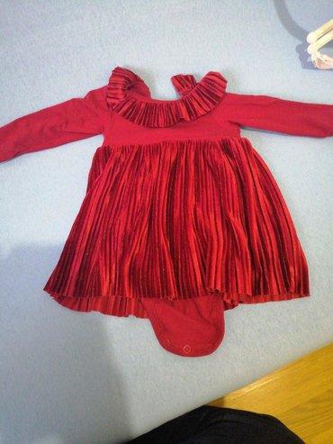 HM haljinica broj 62 trula visnja je boja a na slikama je ovako