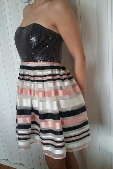 Prelepa P.S. haljina. Samo jednom nosena. Kao nova je,nema ni jednu