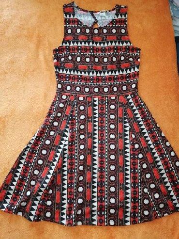 Haljine - Sremska Kamenica: Prodajem H&M haljinu u S velicini. Duzina 89cm, poluobim ispod