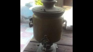 Göyçay şəhərində Bu samovar 1896-ci ile aiddir.Uzerinde pul resmleri var.