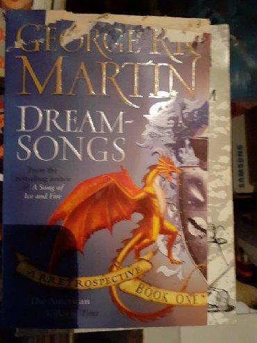 Knjige, časopisi, CD i DVD | Pozega: George R. R. Martin DREAMSONGSKnjiga nije korišćena, ali ima oštećenje