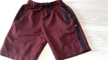 butsy firmennye nike в Кыргызстан: Шорты Nike 32 размер. Бордовые Цвет классно смотрится в живую