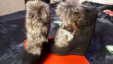 Продаю ботиночки новые . Утеплённые . снаружи чернобурка.На