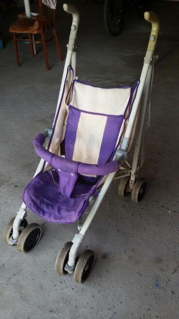 Купить бэушный телефон недорого - Кыргызстан: Недорого коляска складная.Колёса целые,спинка откидывается.Всё