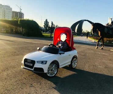 Машина Ауди а7Почти новая купили год назад за 22000 сом. Пару раз