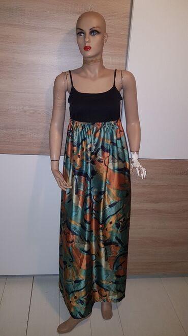 Haljine - Paracin: Suknja jednom ponesena samo stajala.moze se nositi kao haljina s