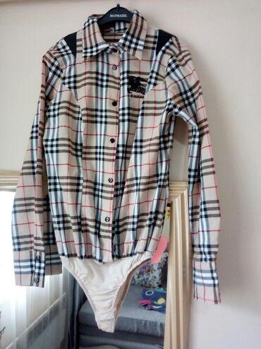 Да, АКТУАЛЬНО  фирменная рубашка-боди от Burberry. Состояние как ново