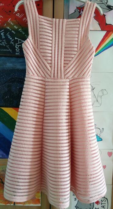 Платье нежно розового цвета .Подойдёт как для простого ношения так и