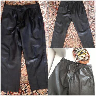 Kožne ženske pantalone XLOčuvane crne kožne pantalone, ve l piše 50