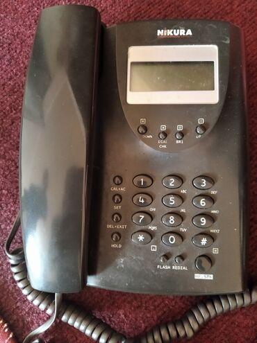 Продаю в городе Каракол стационарный телефон Nikura.В отличном