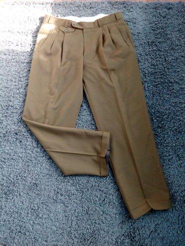 Muske pantalone. Maslinaste boje L - Kladovo