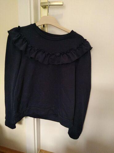 Prelep džemper plave boje sa karnerima Brend je H&M