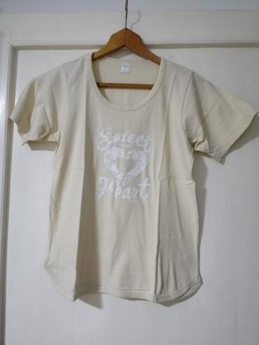 Ženska bež majica kratkih rukava Veličina M Polovna, ali lepo očuvana  - Obrenovac