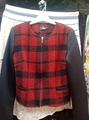 Женские пиджаки, жакеты, юбочные и брючные костюмы производства