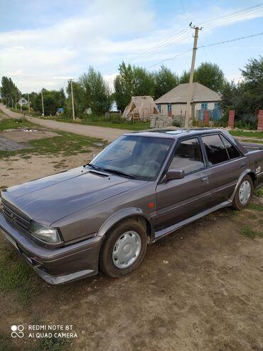 Транспорт - Кызыл-Суу: Nissan Bluebird 1.8 л. 1989 | 247540 км