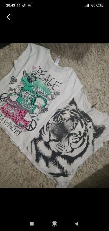 Dve majice za napisanu cenu cia a bilo kakva dodatna pitanja, slika