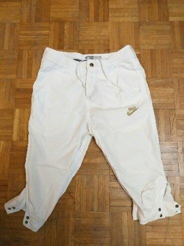 Original Nike ženske 3/4 pantalone.Odlicno ocuvane.Velicina 34 - Obrenovac