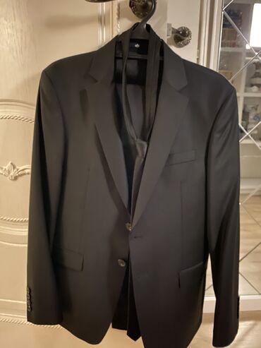 Продается классический чёрный костюм. Пиджак, брюки и галстук.  В идеа