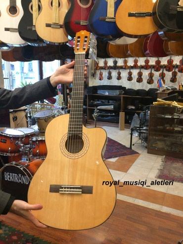 Bakı şəhərində Rivertone klassik gitara,qosulmali.Canta hediyye verilir.