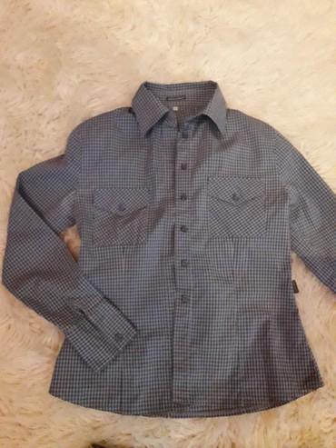 Košulja Azzarro vel 42, cena 300 din i ESPRIT suknja vel 29 (obim s