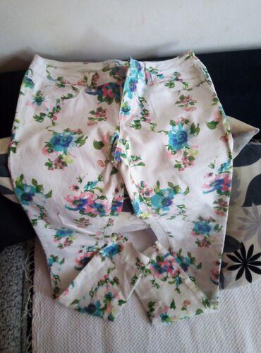 Kao noveee moderne i kvalitetne cvetne pantalone farmerke 40 vel ili L