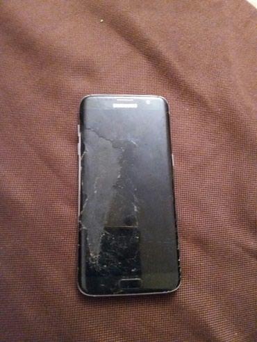 Samsung s7edge ekran sinib tekce bele her sey iwlek в Bakı