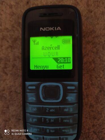 Nokia 1200 satılır her şeyi isliyir problem yoxdu işgal alçı zeng