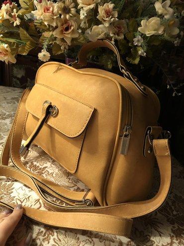Narıncı rengde~ mat deriden ibaret xanimlarimiz üçün çanta.Çantanin