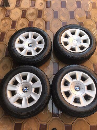 bmw kaplja в Кыргызстан: Продаю диски с жирной зимней резиной на БМВ. 205/65/R15 стояли на е39