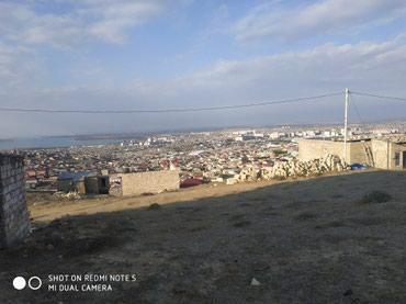 Bakı şəhərində Hokumelide Beton yoldan 500 metr  icerde sotu 900 man  olan torpaq