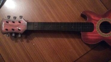 Ucuz telfonlar - Azərbaycan: Suvenir ses cixara bilen ucuz qiymete gitara satilir.Hec bir problemi
