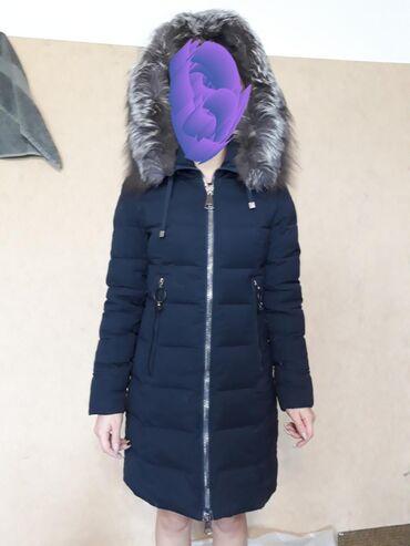 Зимняя куртка на девочку б/у. В отличном состоянии.Мех
