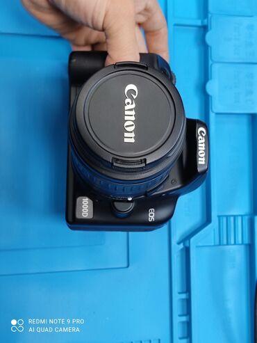 Canon 1000d В комплекте 16гб флешка, 2 акб сколько заряд держит я не