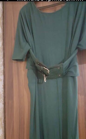 Женское трикотажное платье зеленого цвета. размер 38/ m. производство