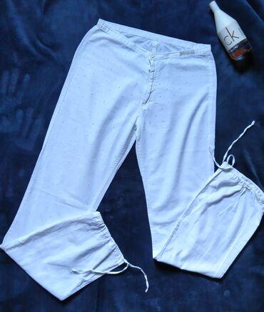 Pantalone cm - Srbija: Tiffany bele lanene pantalone visokog struka, rupicaste.Nogavice su