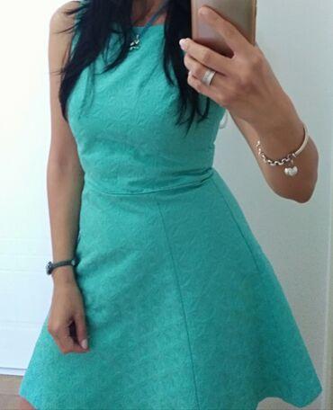Prelepa haljinica mint boje, vel. 38, kvalitetan materijal i divan