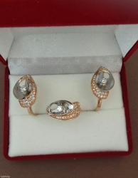 комплект из красного золота 585 проба. С бриллиантами. 50кр57-0,7 3/5;26кр17-0,36 3/5. в Бишкек