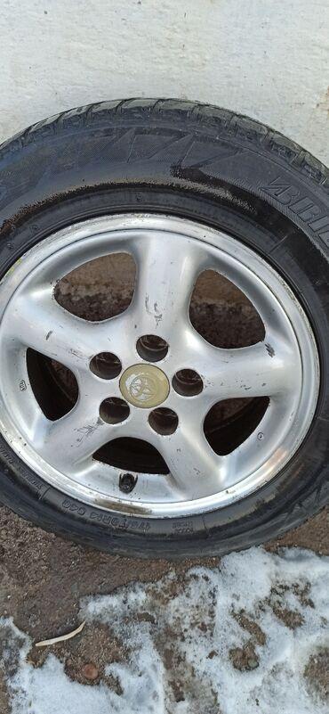 титановые диски бу в Кыргызстан: Продаю титановые диски диаметр 14 вместе с покрышками прошу 10 500 от