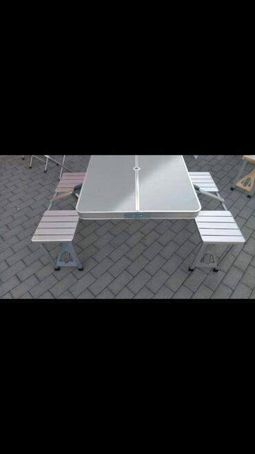 Masa ve oturacaq acilib yigilan