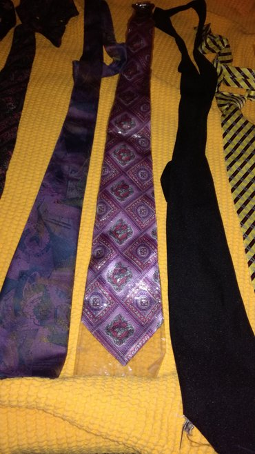 Purple tie with various designs (left one)
