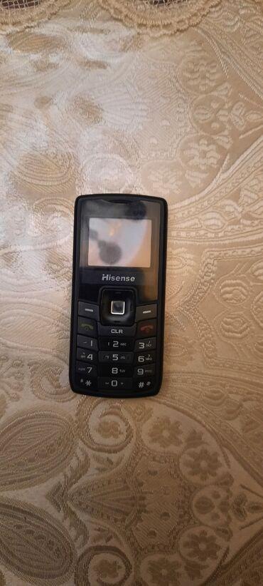 Samsung - Novxanı: Hisense telefon. Teze kimi qalib.Zaryatka yaxsi saxlayir.Adaptr