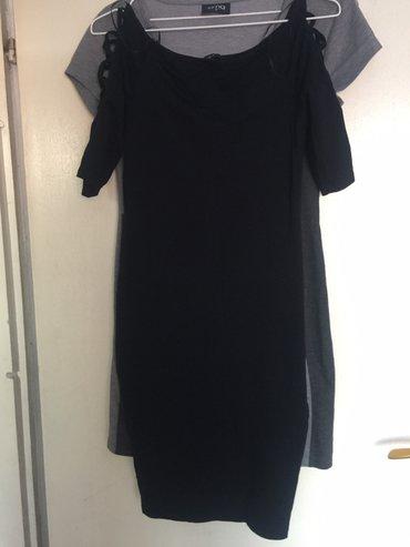 Crna haljinica sa otvorom na rukavima L novo