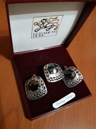 Продаю б/у серебряный комплект ,размер кольца 18 в Бишкек